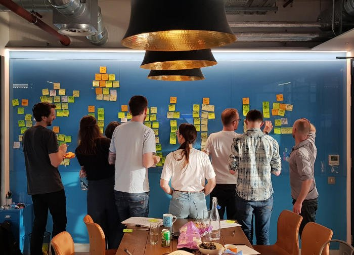 A group of people brainstorming new ideas in a workshop.